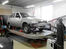 Фото процесса восстановления геометрии кузова авто